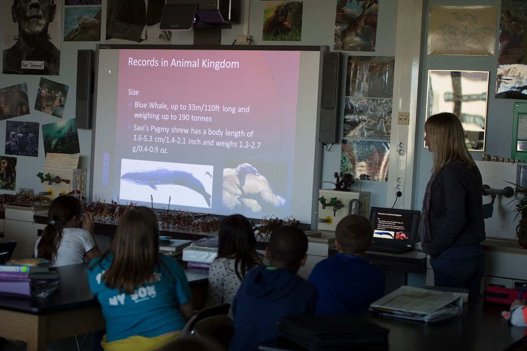 Astid Waaerius, 52nd Civil Engineer Squadron environmental engineer, gives an overview of wildlife on the planet during an Earth Day classroom presentation at Spangdahlem Middle School, April 22, 2015, on Spangdahlem Air Base, Germany. The 52nd CES environment element hosts classes twice a year. (U.S. Air force photo by Staff Sgt. Christopher Ruano/Released)
