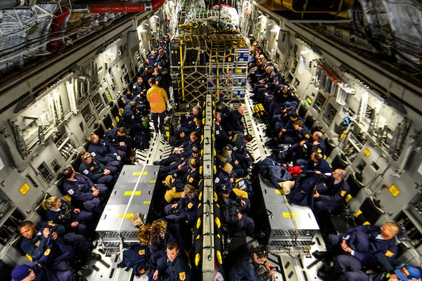 Members of the Fairfax County Urban Search and Rescue Team await takeoff on a U.S. Air Force C-17 Globemaster III from Dover Air Force Base, Del., April 26, 2015. The 69-person team is deploying to Nepal, along with about 70,000 pounds of supplies, in support of disaster-recovery operations after the country was struck by a 7.8-magnitude earthquake. U.S. Air Force photo by Airman 1st Class William Johnson