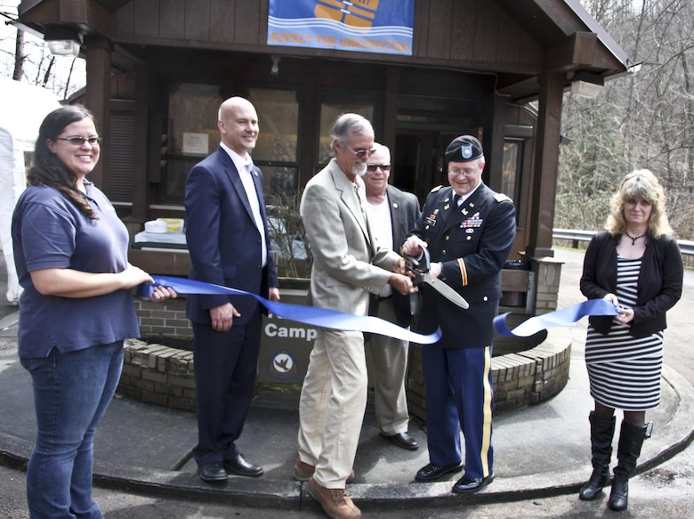 Dignitaries cut the ribbon on a new partnership at Tub Run Campground in Confluence, Pa., April 9. Cutting the ribbon was Elizabeth McCarty (left), Senator Pat Stefano, Mark McCarty, Neal Christopher, Lt. Col. Gerald Dull, and Sheila Shea.