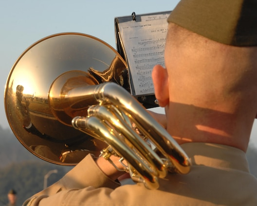A Marine from the Albany Marine Band plays his musical instrument during a morning colors ceremony held in front of Marine Corps Logistics Base Albany's headquarters,  Feb. 18, 2011. Marine Corps Logistics Command officials honored the former Albany Marine Band with a display showcase and small ceremony April 28, 2015, in Logistics Command's Headquarters Building, here.