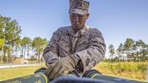 Corporal Christian Sampson, a squad leader with 2nd Combat Engineer Battalion, 2nd Marine Division, and Salina, Kan., native, handles a high explosive, dual purpose rocket before firing the shoulder-launched multipurpose assault weapon during live-fire training aboard Camp Lejeune, N.C., April 23, 2015. The Marines also trained with the M203 40mm grenade launcher, a single shot, under-barrel grenade launcher that is attached to an M16-A4 service rifle.