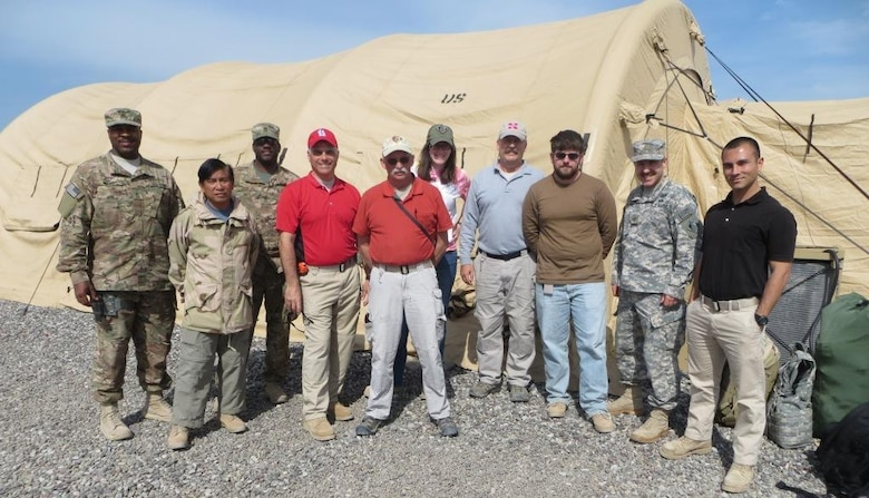 The 542nd Forward Engineering Support Team - Advanced gathers for a group photo at a camp in Iraq. The team is completing a six-month deployment supporting the Combined Joint Task Force with a wide array of engineering missions across the U.S. Central Command area of responsibility.
