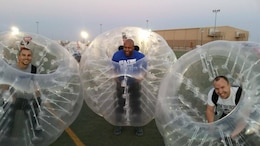 Three members of the 542nd Forward Engineering Support Team - Advanced compete in a base-sponsored BubbleBall soccer tournament. BubbleBall is the latest sports craze that encases players in the center of an over-sized polyvinyl bubble ball during play. Between missions, FEST-A members recreate during team-building activities or connect with family and friends in the states via FaceTime, Skype and other forms of electronic communication.