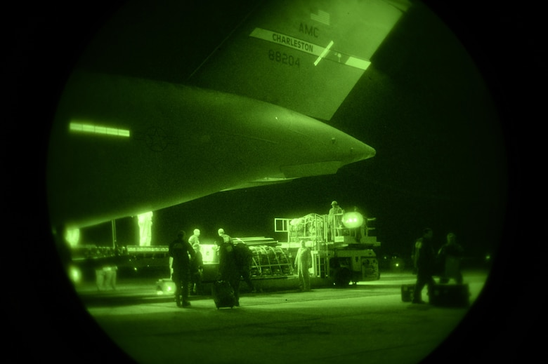 U.S. Air Force Airmen offload relief supplies for victims of the Nepal earthquake from a USAF C-17 Globemaster III April 28, 2015. The Air Force transported relief supplies along with members of the United States Agency to International Development (USAID), the Los Angeles County Search and Rescue team and five search and rescue dogs to Katmandu, Nepal. (U.S. Air Force photo/Airman 1st Class Taylor Queen)