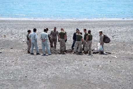 Marines, sailors, and civilians from CATC Camp Fuji conducted a clean-up of the Marine Corps training area at Numazu Beach in commemoration of Earth Day, Thursday April 23, 2015.