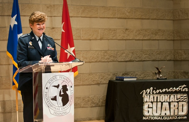 U.S Air Force Gen. Janet Wolfenbarger, Commander of the Air Force Material Command, speaks at the first annual Joint Female Professional Development Training Symposium in St. Paul, Minn., April 18, 2015. The symposium focused on personal and professional development of female airmen and soldiers in the military. The symposium topics included resiliency and retention, exposure to extraordinary female leadership, and also included activities that supported inclusion and diversification of thought and talent.  (Minnesota National Guard photo by Staff Sgt. Austen Adriaens/ Released)