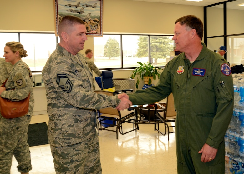Chief Master Sgt. Sean Applegate, Army & Air Force Exchange Service's senior enlisted advisor is welcomed by Col. Russ Walz, 114th Fighter Wing commander, during his visit to the Sioux Falls Exchange April 24, 2015.  Applegate toured the Exchange facility and met with Airmen to address how the Exchange can better serve them. (National Guard photo By Senior Airman Duane Duimstra/Released)