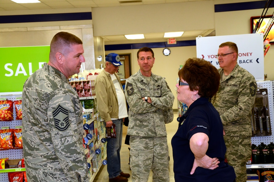Chief Master Sgt. Sean Applegate, Army & Air Force Exchange Service's senior enlisted advisor, meets with Sherri Oster, the Sioux Falls Exchange store manager, during his visit to the 114th Fighter Wing April 24, 2015. Applegate toured the Exchange facility and met with Airmen to address how the Exchange can better serve them. (National Guard photo By Senior Airman Duane Duimstra/Released)