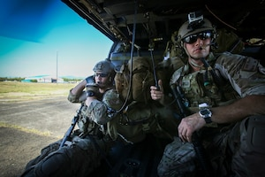 U.S. Air Force Staff Sgt. Dylan Crawford, left, and SSgt. Jason Jason Fischman, both pararescuemen with 31st Rescue Squadron, prepare for take off as they respond to a notional mass casualty incident during Exercise Balikatan 2015, in Clark Air Base, Philippines, April 24. The drill was conducted alongside rescuemen from the 505th Rescue and Search Group of the Philippine Air Force. The bilateral training event provided both rescue teams with a better understanding of how each other operates and ensures mission accomplishment should they work side-by-side in the future. Balikatan is an annual Philippines-U.S. military training exercise and humanitarian assistance engagement, which highlights the long standing partnership between both the nations.
