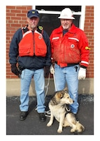 Wayne Adams (left) and Alan Craigmyle rescued Lucky the husky at Markland Locks and Dam, Warsaw, Ky.