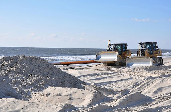 Bulldozers distribute newly-placed sand on Westhampton Beach, N.Y., Nov. 21, 2014. The sand, pumped onto the beach from an approved-offshore borrow site, repaired severe erosion caused by Hurricane Sandy in 2012.