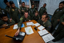 U.S. Air Force aircrew from the 36th Airlift Squadron, Yokota Air Base, Japan, conduct mission plan for an airdrop with Philippine air force aircrew from the 220th Airlift Wing, at Brig. Gen. Benito Ebuen Air Base, Philippines, April 25, as part of exercise Balikatan 2015. Bilateral training, such as the kind practiced at BK15, proved its effectiveness when Philippine and U.S. forces conducted a relief mission in November 2013 during Operation Damayan in the wake of Super Typhoon Haiyan, which devastated more than 35 provinces in the Philippine and displaced nearly half a million residents.