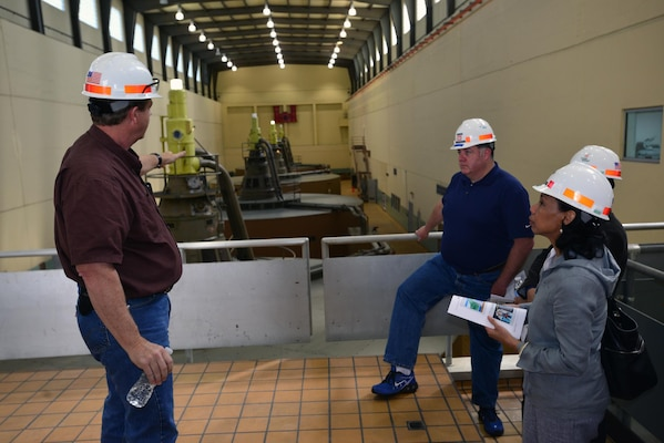 Steven Crawford, a hydropower trainee briefs the group on the operation of generating hydropower during a tour at the Old Hickory Power Plant April 23, 2015.