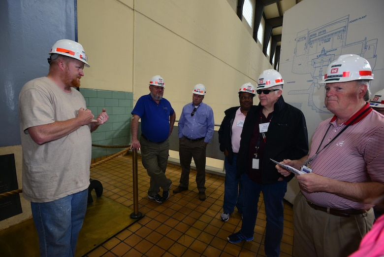 Nicholas Pilcher, a hydropower trainee, from the Old Hickory power plant, explains to the Federal Utility Partnership Working group the process of water flow and generator operations at the Old Hickory Dam in Hendersonville, Tenn., April 23, 2015.
