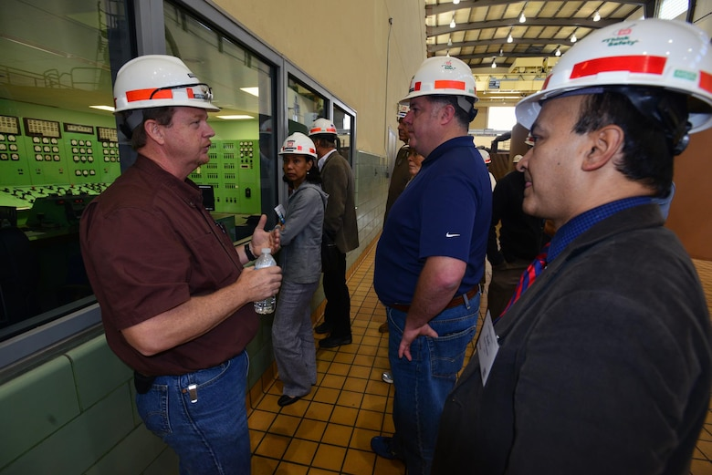 Steven Crawford, a hydropower trainees from the Old Hickory power plant, explains how the control room works to a group from the Federal Utility Partnership Working group during a tour at the Old Hickory Dam in Hendersonville, Tenn., April 23, 2015.