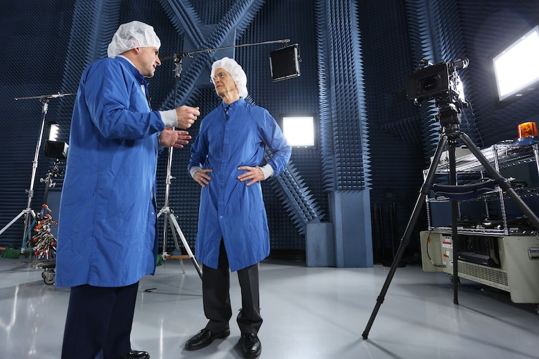 CBS/60 Minutes correspondent Dave Martin (right) interviews Brig. Gen. Bill Cooley, director of the GPS directorate for the Space and Missile Systems Center, inside a special satellite test chamber at the Boeing facility in El Segundo, California for a two-part segment on Air Force Space Command that aired April 26, 2015. (Photo by Maj Eric Simon)