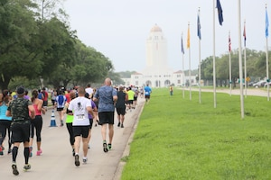 Joint Base San Antonio members run down Harmon Drive April 26 during the start of the JBSA Half Marathon at JBSA-Randolph. In its second year, the race not only provided an opportunity for members from all JBSA locations to tour the scenic route and rich history of JBSA-Randolph, but to experience camaraderie and teamwork between runners and volunteers alike throughout the event.
