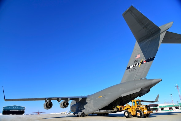 A C-17 assigned to the New York Air National Guard's 105th Airlift Wing is loaded with snowmobiles on the gravel and snow runway at Cambridge Bay, Nunavut, Canada, March 23, 2015. The wing flew supplies into the Canadian Arctic in support of the New York Air National Guard's 109th Airlift Wing which is participating in the Canadian Forces Operation NUNALIVUT 2015, an annual exercise in the high Arctic. (U.S. Air National Guard photo by Maj. Ryan Daughtery/Released)