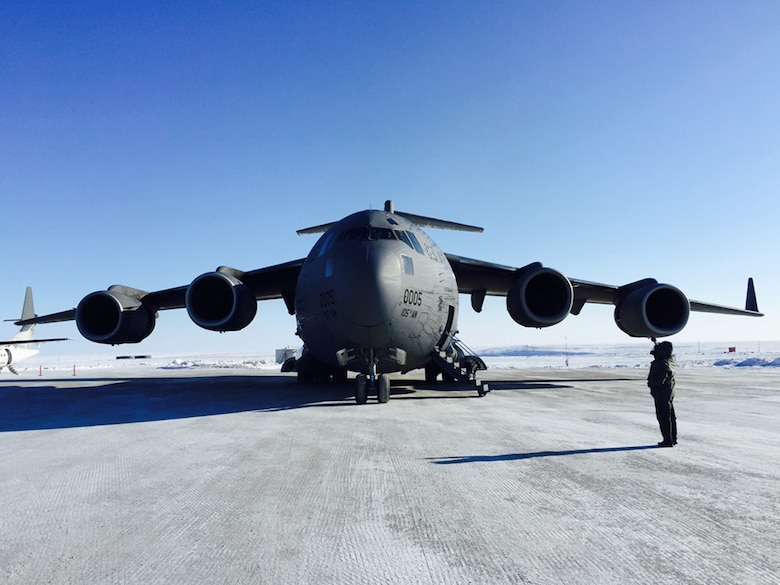 A C-17 assigned to the New York Air National Guard's 105th Airlift Wing sits on the gravel and snow runway at Cambridge Bay, Nunavut, Canada, March 23, 2015. The wing flew supplies into the Canadian Arctic in support of the New York Air National Guard's 109th Airlift Wing which is participating in the Canadian Forces Operation NUNALIVUT 2015, an annual exercise in the high Arctic. (U.S. Air National Guard photo by Major Ryan Daughtery/Released)