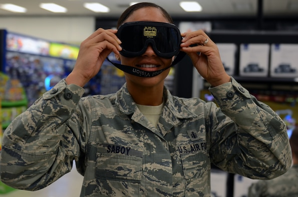 Staff Sgt. Danyelle Saboy, 36th Medical Support Squadron, tries on impaired vision goggles at The Exchange at Andersen Air Force Base, Guam, April 24, 2015. The 36th Medical Operations Squadron Alcohol and Drug Abuse Prevention and Treatment program put on a drunken Mario Kart competition and a drunken golf cart obstacle course for participants to maneuver while wearing impaired vision goggles to show Airmen and their families the effects of alcohol on motor skills in recognition of Alcohol Awareness Month. (U.S. Air Force photo by Airman 1st Class Alexa Ann Henderson/Released)