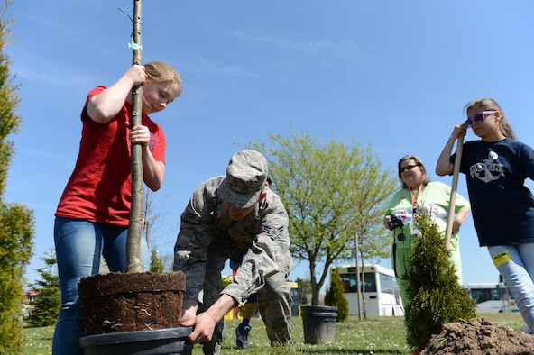 Students from Spangdahlem Middle School and local girl scouts took part in the annual Earth Week tree planting at Spangdahlem Air Base, Germany, April 24, 2015. Four trees were planted this year as part of the environmental awareness event. (U.S. Air force photo by Senior Airman Sarah Denewellis/Released)