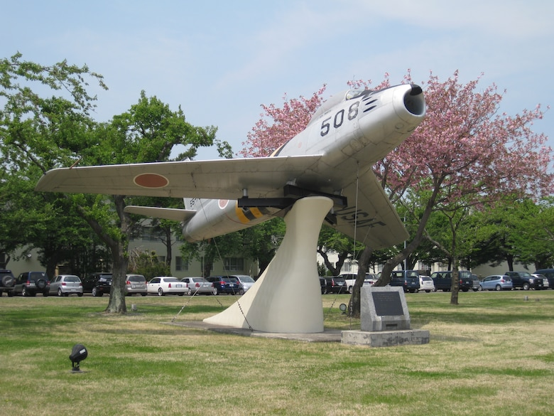 The F-86 on display in Risner Circle, Misawa AB, Japan features both U.S. and Japanese markings to recognize the bilateral friendship of the two nations.  (Released/U.S. Air Force photo)