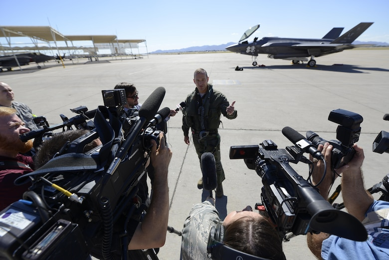 Brig. Gen. Scott Pleus, the 56th Fighter Wing commander, speaks with U.K. and Arizona-based media outlets after landing the flagship F-35 Lightning ll at Luke Air Force Base, Ariz., April 28, 2015. The flagship's arrival coincides with the start of Luke's F-35 student pilot training, which begins in May. Luke now has 20 U.S. F-35s and two from the Royal Australian Air Force. (U.S. Air Force photo/Senior Airman Devante Williams)