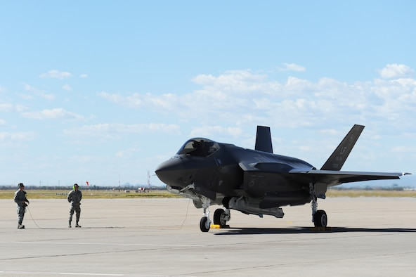 Brig. Gen. Scott Pleus, the 56th Fighter Wing commander, lands the flagship F-35 Lightning ll at Luke Air Force Base, Ariz., April 28, 2015. The flagship's arrival coincides with the start of Luke's F-35 student pilot training, which begins in May. Luke now has 20 U.S. F-35s and two from the Royal Australian Air Force. (U.S. Air Force photo/Senior Airman Devante Williams)