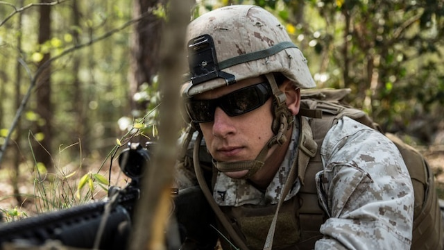 Lance Cpl. Richard Emmis, a rifleman with Charlie Company, 1st Battalion, 2nd Marine Regiment and native of Corona, California, posts security during a patrol to identify improvised explosive devices aboard Fort A.P. Hill, Virginia, April 21, 2015. Locating IEDs prepares Marines with 1st Bn., 2nd Marines for their upcoming deployment to Okinawa, Japan this fall. (U.S. Marine Corps photo by Lance Cpl. Immanuel Johnson/Released)