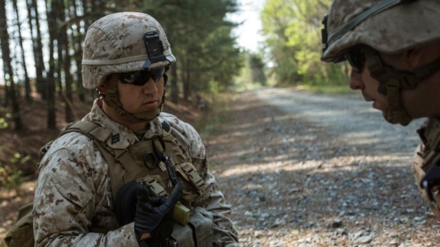 Seaman Joseph Marfia, a corpsman with Charlie Company, 1st Battalion, 2nd Marine Regiment and native of Arecibo, Puerto Rico, assesses a mock-casualty from an improvised explosive blast during a patrol aboard Fort A.P. Hill, Virginia, April 21, 2015. This training helps corpsmen get familiar with treating a casualty who experienced an IED blast. (U.S. Marine Corps photo by Lance Cpl. Immanuel Johnson/Released)