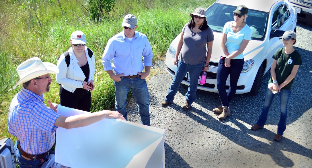 Learning about a commercial biodiversity mitigation site in Galt, California, an interagency team visits a 495-acre project operated by Westervelt Ecological Services. From left to right are Matt Gause, Westervelt senior ecologist; Sophie Menard, University of Versailles, France; Travis Hemmen, Westervelt market development specialist; Melissa France and Kaitlyn Pascus, U.S. Army Corps of Engineers Sacramento District regulatory specialists; and Ali Dunn, California Department of Fish and Wildlife.