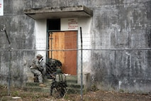 A U.S. Army Observer-Controller-Trainer monitor assigned to the Philippine Army's 7th Infantry Division setup breaching explosives on a door during tactical-level field training as part of exercise Balikatan 2015 at Ft. Magsaysay, Philippines, April 23. U.S. Soldiers from 1st Battalion, 27th Infantry Regiment, which is a part of 2nd Stryker Brigade Combat Team, have been working shoulder-to-shoulder with Philippine soldiers from the 7ID during BK15. Bilateral training exercises, such as Balikatan, improve the readiness of both armed forces and helps maintain a high level of readiness, and enhances military-to-military relations and combined combat capabilities.