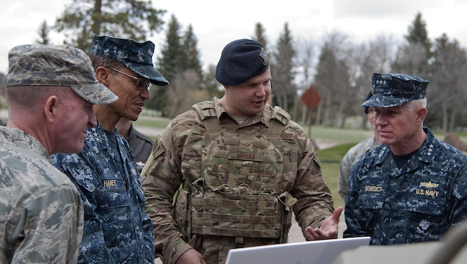 Staff Sgt. Sean Moran briefs Navy Adm. Cecil D. Haney, the U.S. Strategic Command commander; Lt. Gen. Stephen W. Wilson, Air Force Global Strike Command commander; and Navy Vice Adm. Terry Benedict, U.S. Navy Strategic Systems Program director; on a wave relay tactical assault kit radio during a visit to F.E. Warren Air Force Base, Wyo., April 28, 2015. Haney, Wilson and Benedict traveled to F.E. Warren to see the men and women performing the intercontinental ballistic missile mission and to attend the ICBM stakeholders' meeting. Moran is assigned to the 90th Security Forces Support Squadron. (U.S. Air Force photo/Airman 1st Class Brandon Valle)