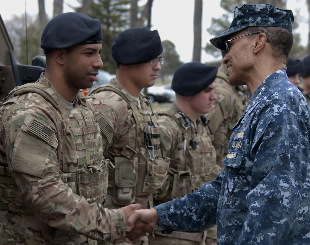 Navy Adm. Cecil D. Haney, the U.S. Strategic Command commander, shakes hands with Senior Airman Shaan Shaffeeullah, a 790th Missile Security Forces Squadron convoy response force member, during a visit to F.E. Warren Air Force Base, Wyo., April 28, 2015. Haney traveled to F.E. Warren to see firsthand the men and women performing the intercontinental ballistic missile mission and to chair the ICBM stakeholders' meeting. (U.S. Air Force photo/Airman 1st Class Brandon Valle)
