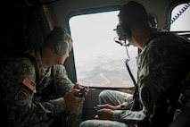 U.S. Army Maj. Gen. Charles A. Flynn (left), commander of the 25th Infantry Division, with Col. David Womack, Commander of 2nd Stryker Brigade Combat Team, 25ID, observe the ground movements of both 2SBCT and Philippine Army Soldiers from a UH-60 Black Hawk during joint training exercise Balikatan 2015, at Fort Magsaysay, Philippines, April 20, 2015. Bilateral training exercises, such as Balikatan, improve the readiness of both armed forces, help maintain a high level of readiness, enhance military-to-military relations and combined combat capabilities.