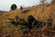 Philippine Army Soldiers assigned to the 7th Infantry Division watch their sectors of fire as a U.S. Soldier assigned to the 25th Infantry Division, observes their execution during a field training exercise at Fort Magsaysay, Philippines, April 20, 2015. The training occurred during joint training exercise Balikatan 2015. Bilateral training exercises, such as Balikatan, improve the readiness of both armed forces, help maintain a high level of readiness, enhance military-to-military relations and combined combat capabilities.