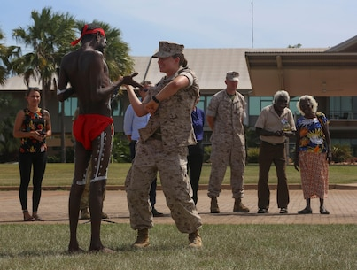 "First Lieutenant Valerie Krygier, motor transport platoon commander, Combat Logistics Detachment 1, Marine Rotational Force – Darwin, dances with an aboriginal dancer with the Kenbi Dancers, during a ""Welcome to Country"" ceremony April 22 at Robertson Barracks, Palmerston, Australia. Brigadier Mick Ryan, commander, 1st Brigade, Australian Army, Australian Defence Force, spoke about the relationship between the Marines and Australians during the MRF-D deployment, and introduced Marines to aboriginal culture by inviting the Kenbi Dancers to conduct a welcoming performance.  MRF-D is the deployment of U.S. Marines to Darwin and the Northern Territory, for approximately six months at a time, where they will conduct exercises and training on a rotational basis with the ADF. (U.S. Marine Corps photo by Lance Cpl. Kathryn Howard/Released)"