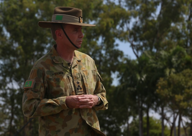 """Brigadier Mick Ryan, commander, 1st Brigade, Australian Defence Force, welcomes U.S. Marines with Marine Rotational Force – Darwin during a """"Welcome to Country"""" ceremony on April 22 at Robertson Barracks, Palmerston, Australia. Ryan spoke about the relationship between the Marines and Australians during the MRF-D deployment, and introduced Marines to aboriginal culture by inviting the Kenbi Dancers to conduct a welcoming performance.  MRF-D is the deployment of U.S. Marines to Darwin and the Northern Territory, for approximately six months at a time, where they will conduct exercises and training on a rotational basis with the ADF. (U.S. Marine Corps photo by Lance Cpl. Kathryn Howard/Released)"""