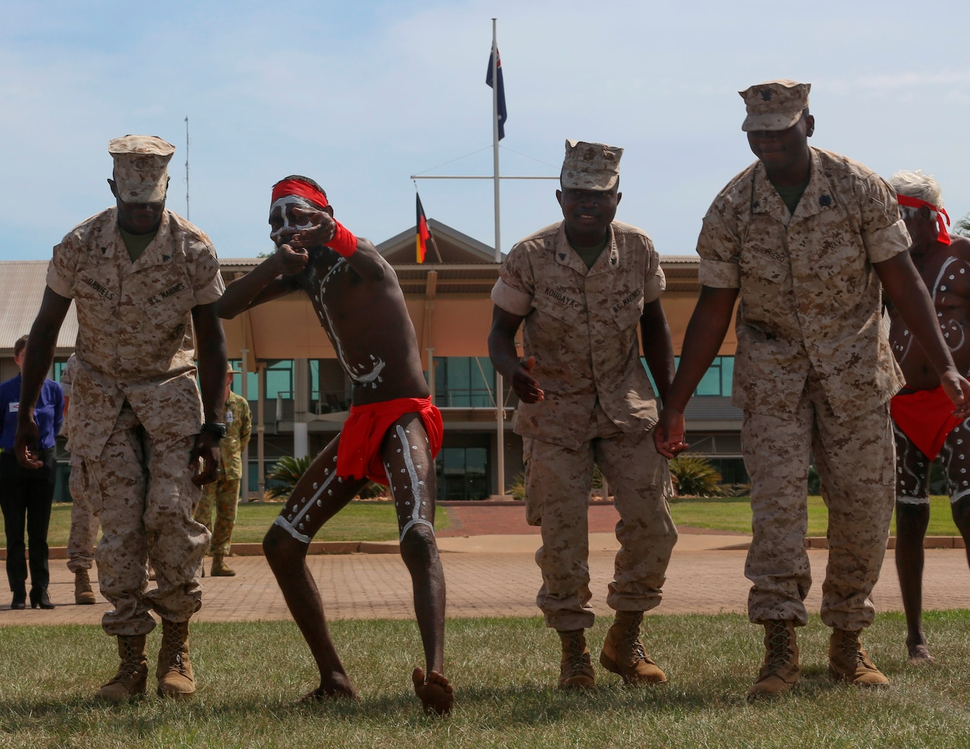 "U.S. Marines with Marine Rotational Force – Darwin dance with aboriginals during a ""Welcome to Country"" ceremony April 22 at Robertson Barracks, Palmerston, Australia. Brigadier Mick Ryan, commander, 1st Brigade, Australian Army, Australian Defence Force, spoke about the relationship between the Marines and Australians during the MRF-D deployment, and introduced Marines to aboriginal culture by inviting the Kenbi Dancers to conduct a welcoming performance. MRF-D is the deployment of U.S. Marines to Darwin and the Northern Territory, for approximately six months at a time, where they will conduct exercises and training on a rotational basis with the ADF. (U.S. Marine Corps photo by Lance Cpl. Kathryn Howard/Released)"
