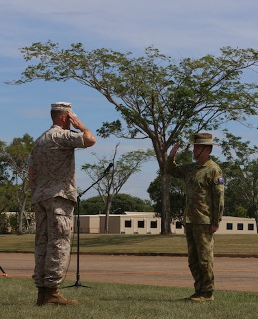 "Lieutenant Colonel Eric J. Dougherty, commanding officer, Marine Rotational Force – Darwin, salutes Brigadier Mick Ryan, commander, 1st Brigade, Australian Army, Australian Defence Force, during a ""Welcome to Country"" ceremony April 22 at Robertson Barracks, Palmerston, Australia. Ryan spoke about the relationship between the Marines and Australians during the MRF-D deployment, and introduced Marines to aboriginal culture by inviting the Kenbi Dancers to conduct a welcoming performance. MRF-D is the deployment of U.S. Marines to Darwin and the Northern Territory, for approximately six months at a time, where they will conduct exercises and training on a rotational basis with the ADF. (U.S. Marine Corps photo by Lance Cpl. Kathryn Howard/Released)"