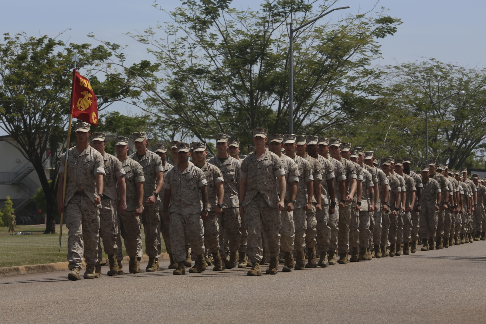 "U.S. Marines with Company C, 1st Battalion, 4th Marine Regiment, Marine Rotational Force – Darwin, march onto the Brigade Parade Ground for a ""Welcome to Country"" ceremony April 22 at Robertson Barracks, Palmerston, Australia. Brigadier Mick Ryan, commander, 1st Brigade, Australian Army, Australian Defence Force, spoke about the relationship between the Marines and Australians during the MRF-D deployment, and introduced Marines to aboriginal culture by inviting the Kenbi Dancers to conduct a welcoming performance. MRF-D is the deployment of U.S. Marines to Darwin and the Northern Territory, for approximately six months at a time, where they will conduct exercises and training on a rotational basis with the ADF. (U.S. Marine Corps photo by Lance Cpl. Kathryn Howard/Released)"