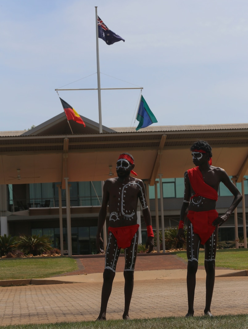 "Kenbi Dancers, an aboriginal dance group, prepare to perform for U.S. Marines with Marine Rotational Force – Darwin by conducting a ceremonial dance during a ""Welcome to Country"" ceremony on April 22 at Robertson Barracks, Palmerston, Australia. Brigadier Mick Ryan, commander, 1st Brigade, Australian Army, Australian Defence Force, spoke about the relationship between the Marines and Australians during the MRF-D deployment, and introduced Marines to aboriginal culture by inviting the Kenbi Dancers to conduct a welcoming performance. MRF-D is the deployment of U.S. Marines to Darwin and the Northern Territory, for approximately six months at a time, where they will conduct exercises and training on a rotational basis with the ADF. (U.S. Marine Corps photo by Lance Cpl. Kathryn Howard/Released)"
