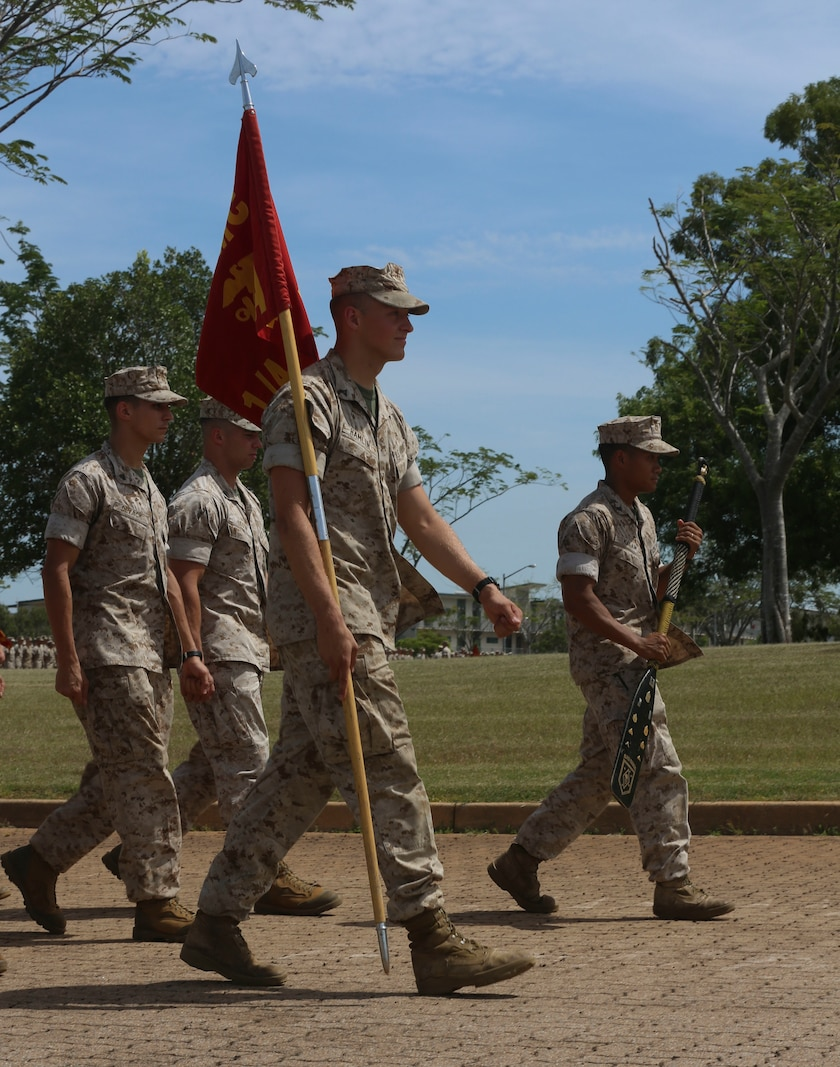 "U.S. Marines with Company A, 1st Battalion, 4th Marine Regiment, Marine Rotational Force – Darwin, march onto the Brigade Parade Ground for a ""Welcome to Country"" ceremony  April 22 at Robertson Barracks, Palmerston, Australia. Brigadier Mick Ryan, commander, 1st Brigade, Australian Army, Australian Defence Force, spoke about the relationship between the Marines and Australians during the MRF-D deployment, and introduced Marines to aboriginal culture by inviting the Kenbi Dancers to conduct a welcoming performance. MRF-D is the deployment of U.S. Marines to Darwin and the Northern Territory, for approximately six months at a time, where they will conduct exercises and training on a rotational basis with the ADF. (U.S. Marine Corps photo by Lance Cpl. Kathryn Howard/Released)"