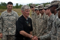 Secretary of the Army John M. McHugh greets Soldiers from the 25th Infantry Division during a visit to the Philippines at Fort Magsaysay, Philippines, April 25, 2015. The secretary's visit was to observe and discuss the joint training exercise Balikatan. Bilateral training exercises, such as Balikatan, improve the readiness of both armed forces, help maintain a high level of readiness, enhance military-to-military relations and combined combat capabilities.