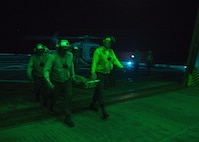 Sailors participate in mass casualty training aboard the forward deployed amphibious transport dock ship USS Green Bay (LPD 20). Green Bay is part of the Bonhomme Richard Amphibious Ready Group and, with the embarked 3rd Marine Division Forward, is currently participating in exercise Balikatan 2015, an annual bilateral exercise conducted with members of the armed forces of the Republic of the Philippines.