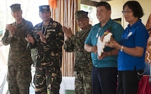 U.S. Marine Maj. Gen Paul Brier, 4th Marine Division commander, joins Armed Forces of the Philippines leadership and barangay, meaning village in Filipino, San Rafael residents, on stage during exercise Balikatan 2015's San Rafael High School ribbon cutting ceremony to celebrate the completed construction of a two-classroom building alongside U.S., Philippine and Australian forces in San Rafael, Palawan, Philippines, April 28. Construction of the BK15 humanitarian civic assistance projects started this past March with the Armed Forces of the Philippines, U.S. forces and Australian forces working shoulder-to-shoulder to construct a two-classroom building for Santa Lourdes National High School, Sabang Elementary School, San Rafael High School and San Rafael Elementary School. This year marks the 31st iteration of the exercise, which is an annual Philippine-U.S. bilateral military training exercise and humanitarian civic assistance engagement.