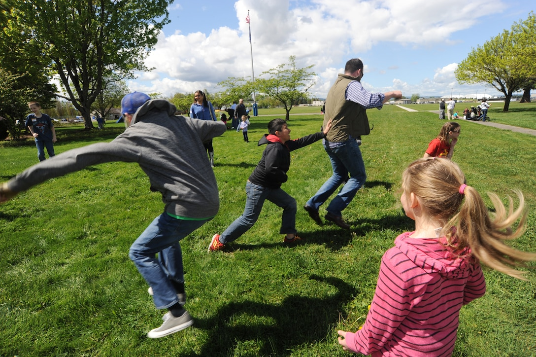 "Family and kids enjoy a game of HOP-TAG during the lunch hour break at the Portland Air National Guard Base, Ore., April 25, 2015 as part of 'Kids Day at PANG.' The Oregon National Guard opened the Portland Air Base to children of military members for a special day of activities highlighting ""The Month of the Military Child,"" designated since 1986 by the Department of Defense as way to recognize the contribution and personal sacrifices children make to the military. (U.S. Air National Guard photo by Tech. Sgt. John Hughel, 142nd Fighter Wing Public Affairs/Released)"