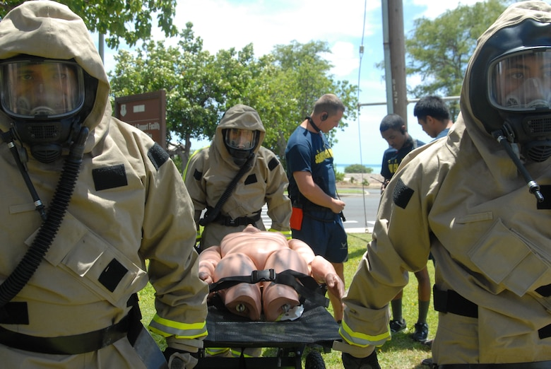 Members of the Hawaii Air National Guard's Fatality, Search, and Recovery Team practice fatality transport while having Powered Air Respirator suits donned at Joint Base Pearl Harbor-Hickam, Hawaii, April 29, 2015. The FSR team is comprised of airmen from the 154th Force Support Squadron. The airmen are prepping for a Vigilant Guard emergency response exercise scheduled to take place this summer. (U.S. Air National Guard photo by Senior Airman Orlando Corpuz/Released)