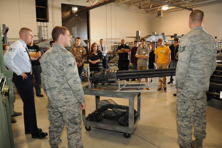 High school students and their parents listen to Airmen from the 114th Fighter Wing weapon shop during the 2015 South Dakota Air National Guard Career Day at Joe Foss Field, S.D., April 29, 2015. The event was held to showcase the many careers within the South Dakota Air National Guard to area high school seniors and juniors.  (National Guard photo by Senior Airman Duane Duimstra/Released)