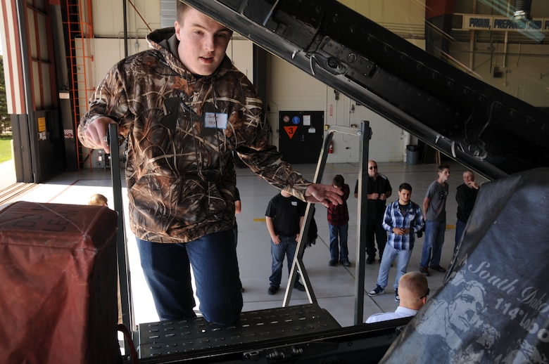 Jordon Heyd, a junior from Canistota, S.D., looks inside an F-16 Fighting Falcon cockpit during the 2015 South Dakota Air National Guard Career Day at Joe Foss Field, S.D., April 29, 2015. The event was held to showcase the many careers within the South Dakota Air National Guard to area high school seniors and juniors.  (National Guard photo by Senior Airman Duane Duimstra/Released)